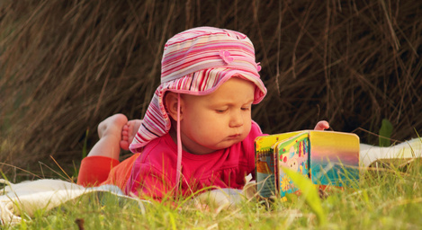 baby is watching a book
