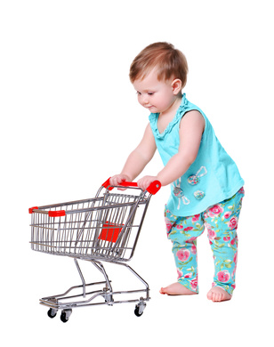 baby girl pushing shopping trolley